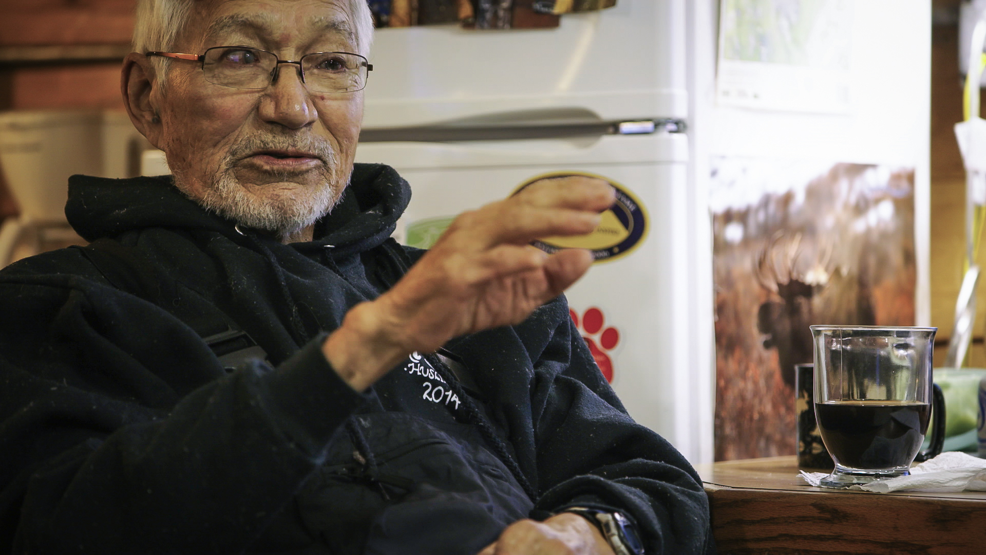 George Attla coaching his grandnephew on the tricks to training a 16-dog sled team.