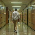 Joseph walks down the hall in Red Folder