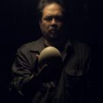 Gil holding a blank egg